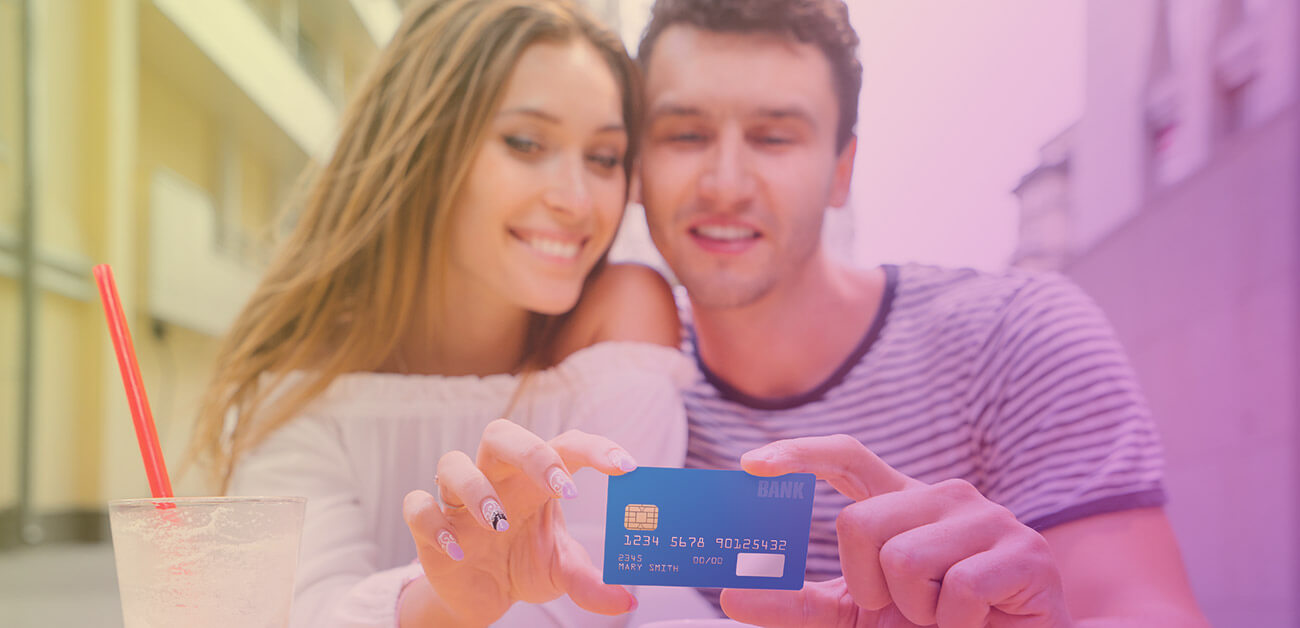 happy couple holding credit card for valentines day
