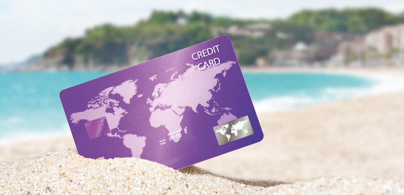 how to save money with a travel credit card image