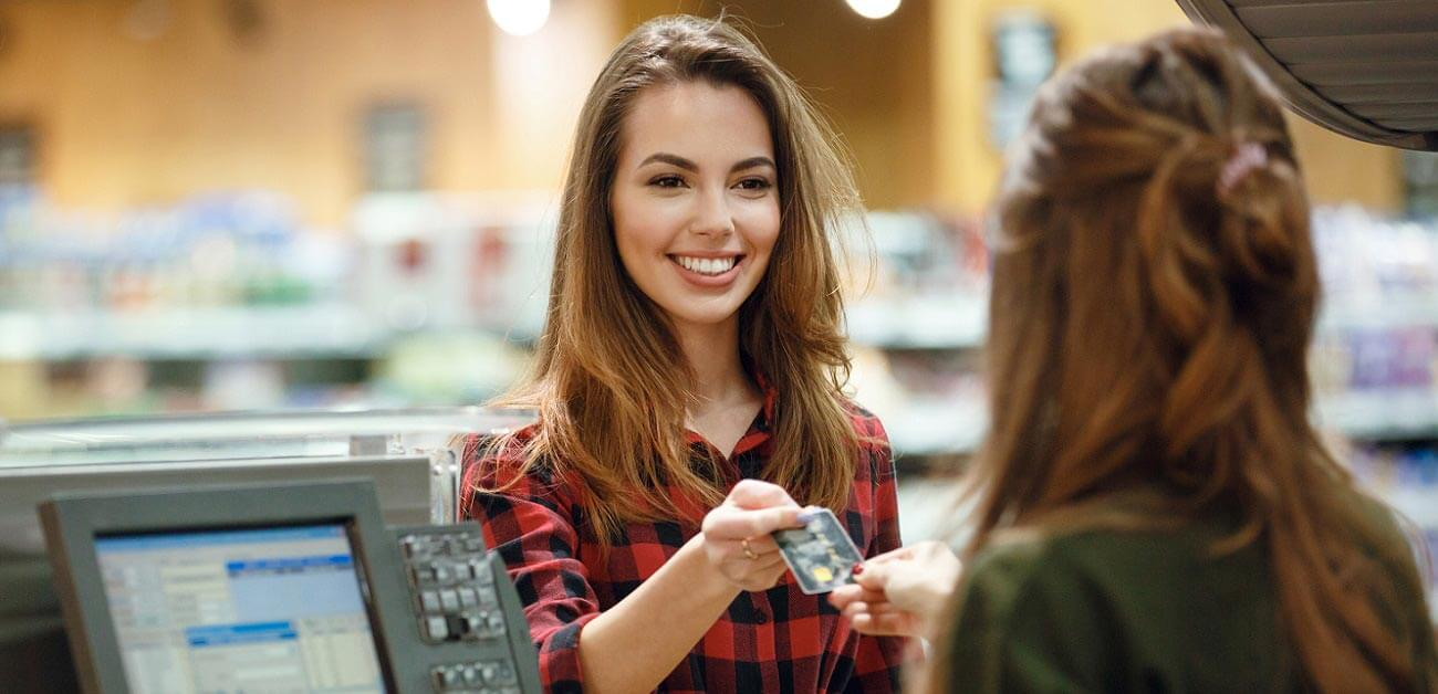 Who has the best loyalty schemes - image of woman paying in supermarket